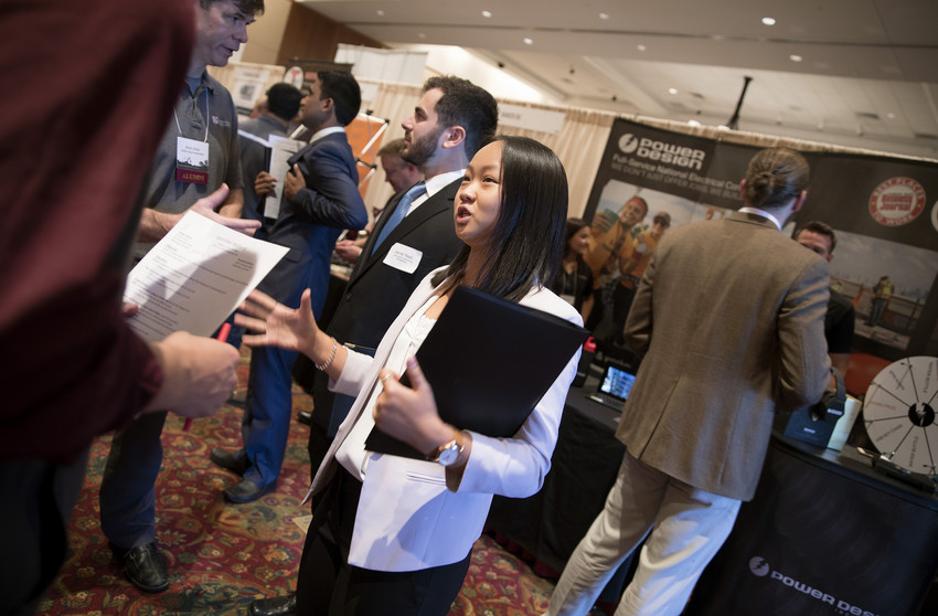 Jennifer Willard, a first-year student at the Myers-Lawson School of Construction, speaks with recruiters from Scott Long Construction during the fall career fair at the Inn at Virginia Tech.